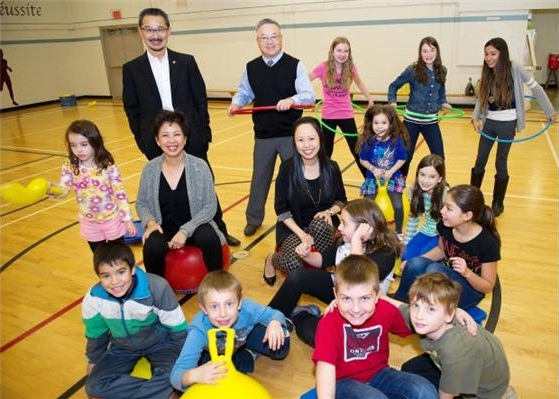 Peter Young, back left, and the Woo family at Richmond's William Bridge Elementary School